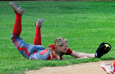 Elyria left fielder Anna Daly dives to catch a ball against Midview. KRISTIN BAUER | CHRONICLE