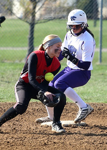 Firelands' Brittany Reising can't get a grip on the ball as Keystone's Summer Constable makes it to second safely. BRUCE BISHOP/CHRONICLE