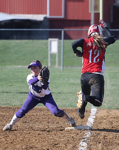 Keystone's first baseman gets the out at first before the Firelands runner tags the bag.  BRUCE BISHOP/CHRONICLE