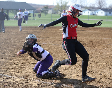 Keystone's catcher can't get the ball around in time to tag the Firelands runner before she scores.  BRUCE BISHOP/CHRONICLE