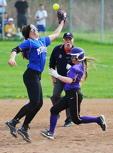 Midview short stop Amanda Beursken jumps to catch a high ball, but misses, as Avon's Alex Kozich slides into second safely. KRISTIN BAUER | CHRONICLE