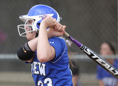 Midview's Amanda Beursken sends a ball deep into right field against Westlake. BRUCE BISHOP/CHRONICLE