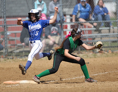 Columbia's Kailey Minarchick gets out a Bishop Ready runner at first base.  RAY RIEDEL/CHRONICLE