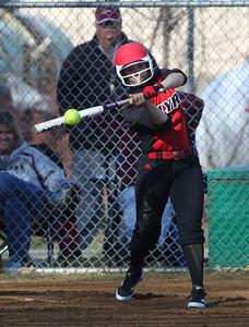 Elyria's Kaitlyn Laseke hits a fly ball. RAY RIEDEL/CHRONICLE