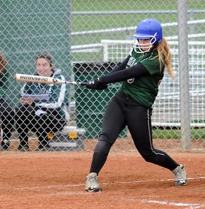 Westlake's Rachel May hits a three-run homer. STEVE MANHEIM/CHRONICLE