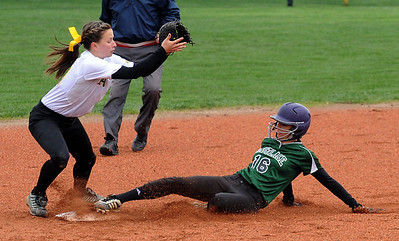 Westlake's Danielle Dill steals second base before Amherst Sarah Miller can tag her. STEVE MANHEIM/CHRONICLE