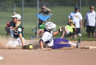 KRISTIN BAUER | CHRONICLE Keystone High School's Paige Hartley (12) slides into second as Holy Name shortstop Cassie Bily (1) fails to secure the ball in time on Thursday evening, May 18.