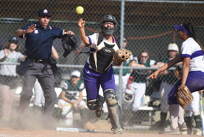 KRISTIN BAUER | CHRONICLE Keystone High School's Summer Metcalf(9) makes a throw to first base in an attempt to get Holy Name's Annessa Whitlow (47) out at first as teammate third baseman Sammie Stefan (24) questions the legality of the bunt on Thursday evening, May 18.