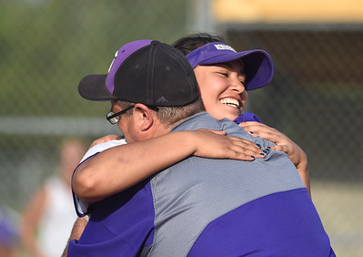 KRISTIN BAUER | CHRONICLE Keystone High School senior Sammie Stefan (24) hugs Coach Jim Piazza after the team beat Holy Name in the District Finals on Thursday evening, May 18.