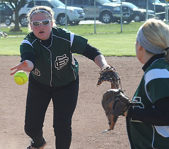 Elyria Catholic Bre Carosella, left, tosses the ball to Trisha Gauntner for a put out Apr. 4.  Steve Manheim