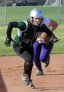 EC Trisha Gauntner is tagged out in a rundown between second and third base in second inning Apr. 4.  Steve Manheim