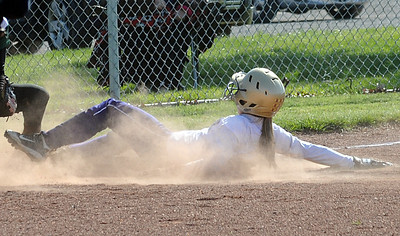 Vermilion's AuBree LaForce slides safe into third base in first inning Apr. 4.  Steve Manheim