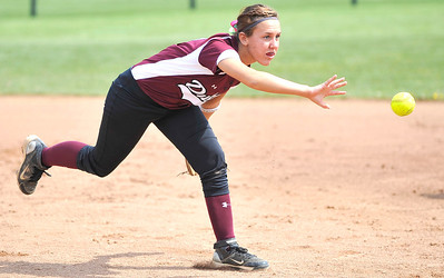 Wellington infielder Amy Scaggs tosses the ball to first base for a putout after the ball ricocheted off the leg of pitcher Allison Rangel yesterday against Garfield. DAVID RICHARD / CHRONICLE