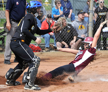 Emily Benko, right, of Wellington scores a run in the sixth inning on a base hit by teammate Regan Regan Moitoret (not pictured). DAVID RICHARD / CHRONICLE