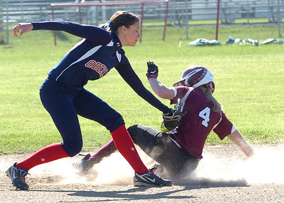 Wellington's Karly Bollin slides safely into second under the tag of Oberlin's #4 Reyna LaRiccia.