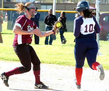 Wellington's pitcher #28 Olivia Wulfhoop tags out Oberlin's #10 Maya Hicks before she reachs first base.