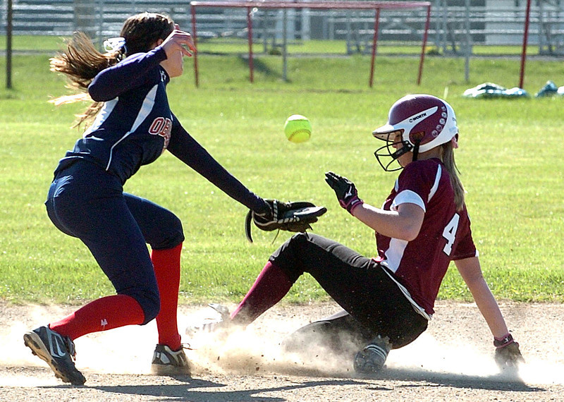 Wellington's Karly Bollin is slides safely into second as Oberlin's #4 Reyna LaRiccia can't keep a handle on the ball.