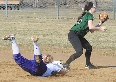 Keystone Destiny Weber slides safe into second base before Westlake Katie Nagel can tag in first inning Apr. 1.  Steve Manheim