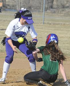 Westlake Erin Brown steals second base as Keystone Summer Constable juggles ball in first inn. Apr. 1.  Steve Manheim