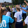 The North Penn Girls Soccer Team rally together before the start of their contest against the Pennridge at North Penn High School on Wednesday October 16,2013. Photo by Mark C Psoras/The Reporter