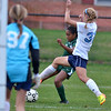 Pennridge's Kennedy Peace ,2, attempts a shot on goal past North Penn defender Lizz Volz ,31, during second half action of their contest at North Penn High School on Wednesday October 16, 2013. Photo by Mark C Psoras/The Reporter