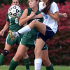 North Penn's Tina Miller ,16, gets a foot on a ball in front of Pennridge's Audrey Butcher ,15, during first half action of their contest at North Penn High School on Wednesday October 16, 2013. Photo by Mark C Psoras/The Reporter