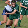 Pennridge's Dani Meehan ,14, pushes past  North Penn defender Ally King ,12, during first half action of their contest at North Penn High School on Wednesday October 16, 2013. Photo by Mark C Psoras/The Reporter