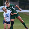 Pennridge's Andrea Caya ,21, and North Penn's Shelby Chiodo ,17, battle for a ball in the air during first half action of their contest at North Penn High School on Wednesday October 16, 2013. Photo by Mark C Psoras/The Reporter