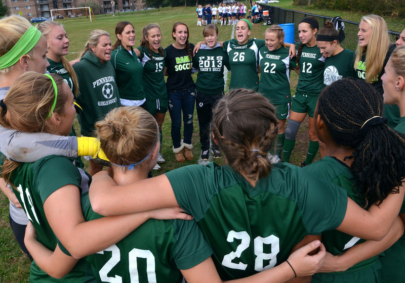 The Pennridge Girls Soccer Team rally together before the start of their contest against the Maidens at North Penn High School on Wednesday October 16, 2013. Photo by Mark C Psoras/The Reporter