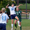 North Penn's Tina Miller,16, and Pennridge's Maddie Swartley  ,18, battle for a ball during first half action of their contest at North Penn High School on Wednesday October 16, 2013. Photo by Mark C Psoras/The Reporter
