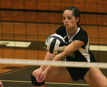 #18 Amherst Vanessa Stacey digs out a service.       photo by Chuck Humel