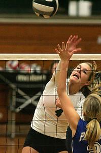 #4 EC Sara Kaminski, Miss Volleyball, slams home a spike.       photo by Chuck Humel