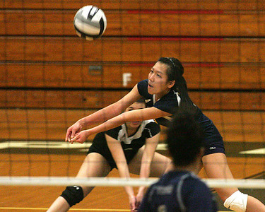 #3 Kimly Pham  of N. Ridgeville digs out a service.         photo by Chuck Humel