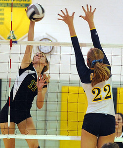 Amherst Maria Concheck hits over Olmsted Falls Kelsey Snider Oct. 4.  Steve Manheim