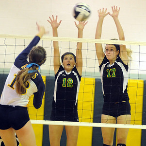 Amherst 12 Kristy Koller nd 17 Maria Concheck defend against Olmsted Falls Abby Davison Oct. 4.    Steve Manheim