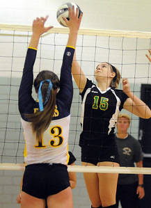 Amherst Morgan Dziak hits past Olmsted Falls Abby Davison Oct. 4.         Steve Manheim