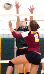 9-6-11 linda murphy  AL's #2Whitney Craigo spikes the ball past Amhersts #15 Morgan Dziak.