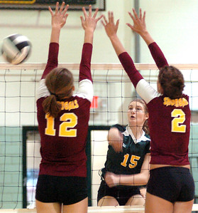 9-6-11 linda murphy  Amherst's #15 Morgan Dziak spikes the ball past AL's #12Christine Bohan & #2 Whitney Craigo