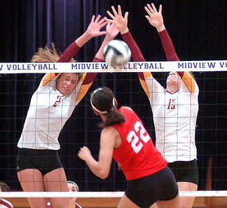Avon Lake's #2 Whitney Craigo and #12 Christine Bohan block Elyria's #22 Alexis Middlebrooke's spike.