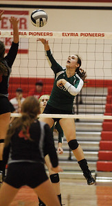 Rachel Duffield spike the ball against Cuyahoga heights. photo by Ray Riedel