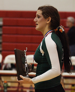 Team captain Catherine O'Shaughnessy holds the district championship 2nd place trophy. photo by Ray Riedel