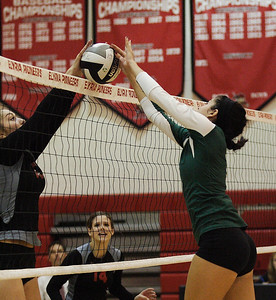 Abbey Flowers battles Hailey Wygonski to dominate the net. photo by Ray Riedel