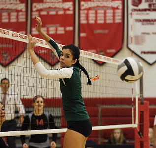 A spike gets past Abbey Flowers in game 3. photo by Ray Riedel