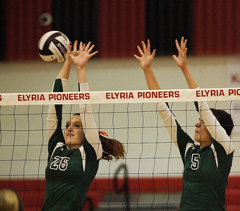 Caitlyn Rock and Abbey Flowers just miss a block against Cuyahoga Heights. photo by Ray Riedel