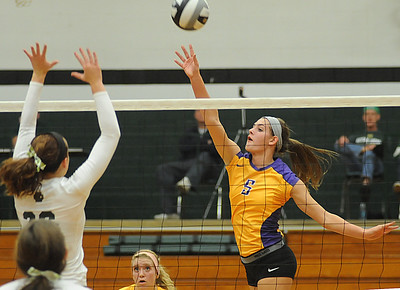 Avon's Brianna Conroy hits over EC's Caitlyn Rock Sep. 25.  photo by Steve Manheim