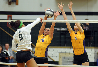 EC's #9 Karissa McGrath hits past Avon's #10 Madi Matisak and #4 Rachel Steinert Sep. 25.  Steve Manheim