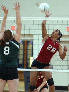 Elyria's Brigette Jones hits over Westlake Lexi Schmidt in sectional volleyball Oct. 21.  Steve Manheim/CT