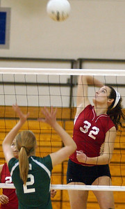 Elyria's Shelby Obitts hits over Westlake Jaclyn Maat in sectional volleyball Oct. 21.  Steve Manheim/CT