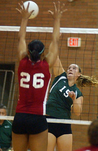 Westlake's Coletta Carmichael hits past Elyria Brigette Jones in sectional volleyball Oct. 21.  Steve Manheim/CT