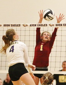 Avon Lake's Kaitlyn Applegate (1) blocks the ball after a strong hit from Avon's Sydney Stone (4) in a match Tuesday, Aug. 25. AMANDA K. RUNDLE/CHRONICLE
